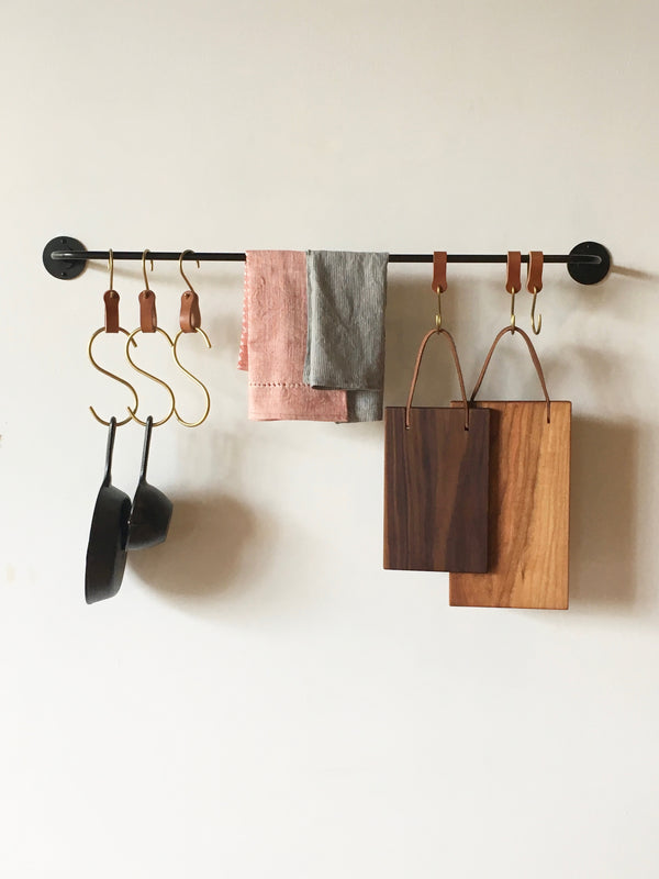 strong potrack with s hooks, cutting boards and iron pans