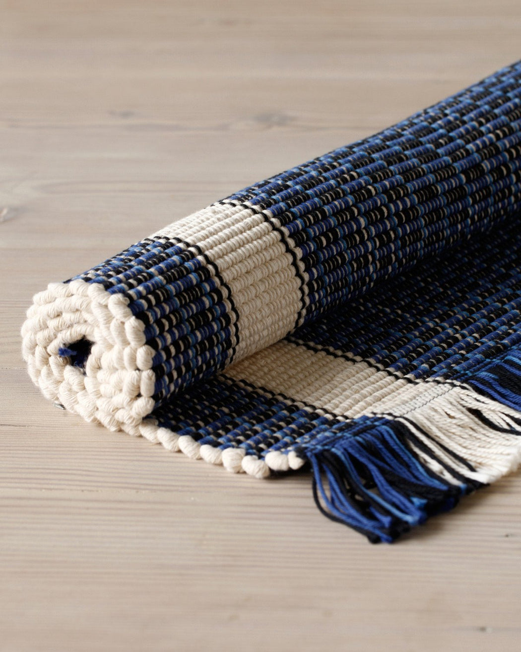 Lostine striped blue and white cotton rug
