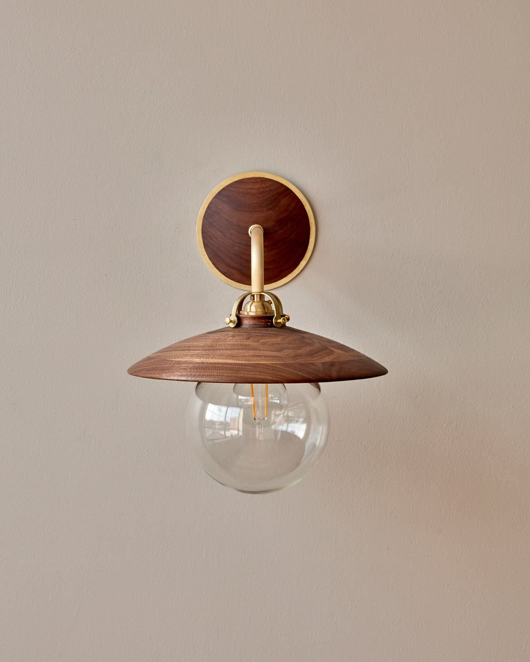 Black walnut and brass Edmund Wall Sconce.  Hardwired lighting made by hand by Lostine in Philadelphia, Pennsylvania.  Simple Interior Design lighting