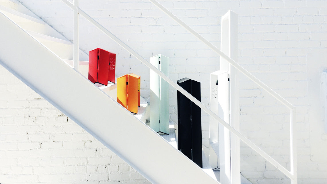 Modern step ladders in red, orange, mint, black, and white. Made in Japan as 1 step, 2 step, 3 step, ladders designed to stand upright on their own.