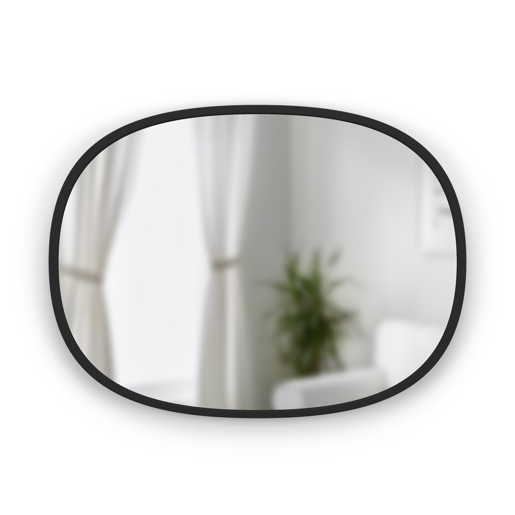 Simple oval wall mirror with thin rubber trim for entryway, living space, or bathroom. Hangs vertically or horizontally. By Umbra at Port of Raleigh
