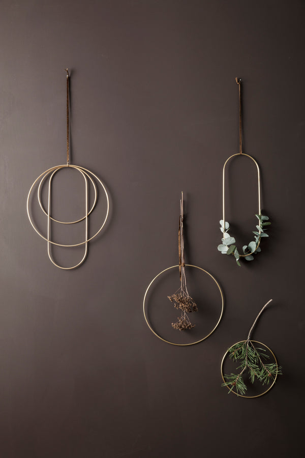 Simple brass circles for wall or window hangings perfect for decorating with foliage and modern winter or christmas decorations. By Ferm Living