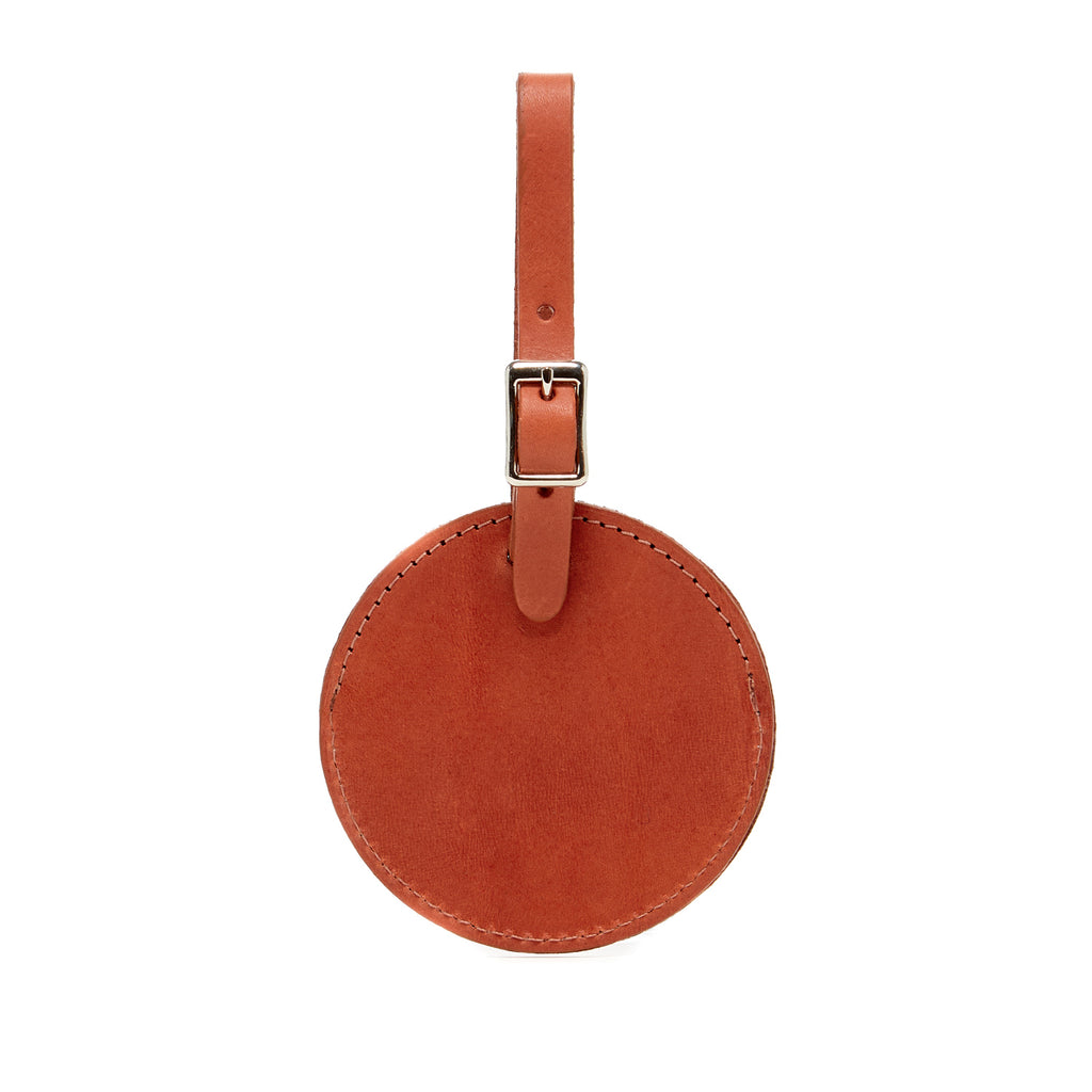 simple minimalist round luggage tags made of vegetable tanned leather in Los Angeles, California USA for travel at Port of Raleigh