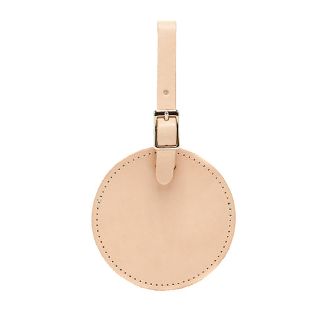 simple minimalist round luggage tags made of vegetable tanned leather in Los Angeles, California USA for travel