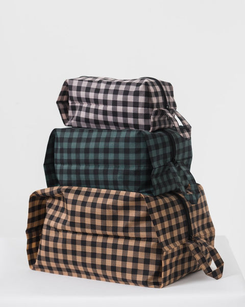Simple, durable, and lightweight - this set of three dark gingham zippered pouches is perfect for travel and home organization. by Baggu at Port of Raleigh