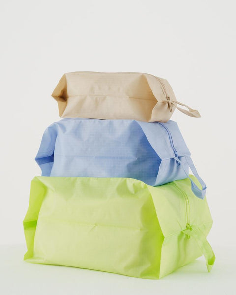Simple, durable, and lightweight - this set of three bright yet subtle zippered pouches by Baggu are perfect for travel and home organization. at Port of Raleigh