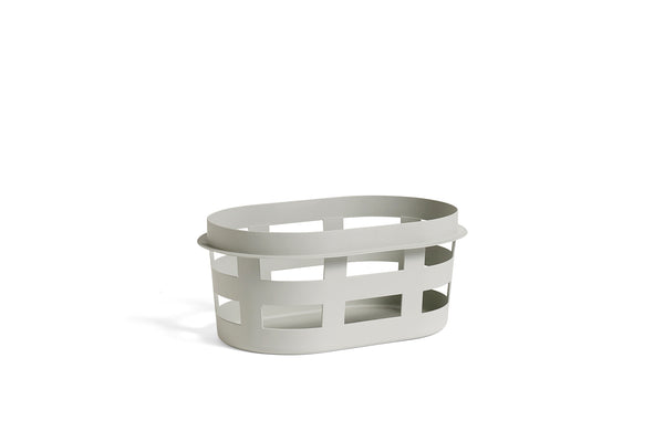 Modern and simple laundry basket by Danish design studio HAY, stackable and made of sturdy plastic. at Port of Raleigh