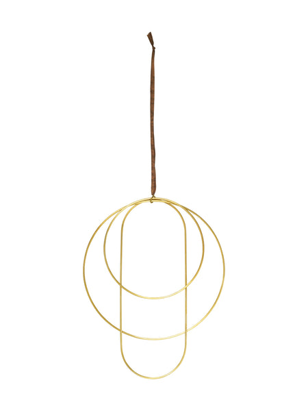 Simple brass circles for wall or window hangings perfect for decorating with foliage and modern winter or christmas decorations. By Ferm Living at Port of Raleigh