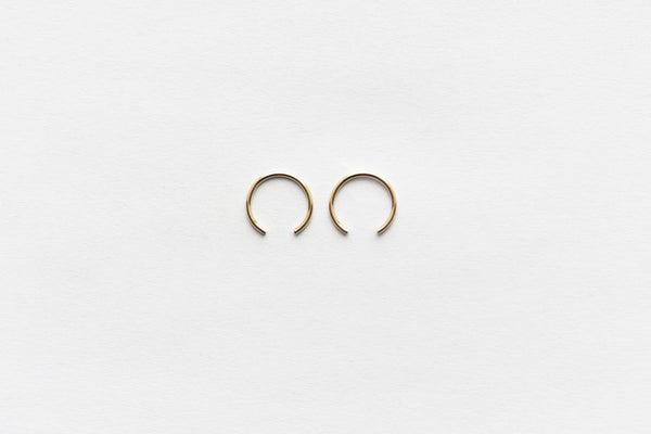 Minimalist earrings in 14K Gold Filled and Sterling Silver made in New York by 8.6.4. Design