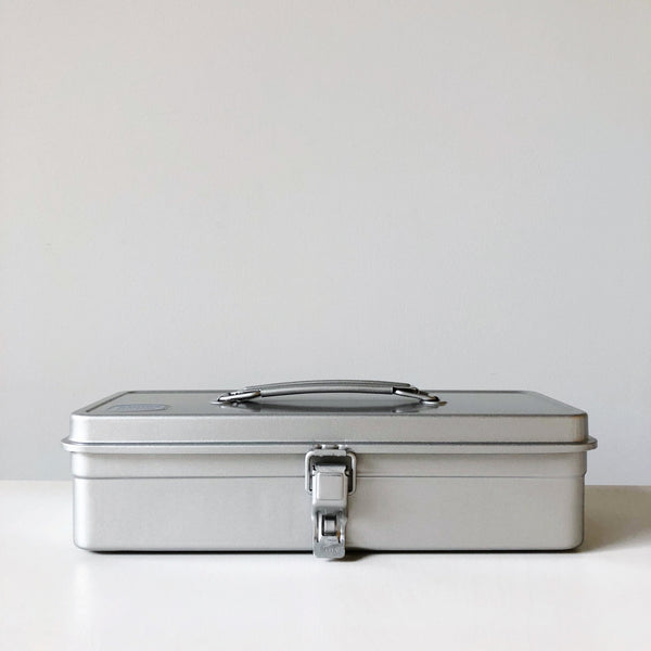 Simple pressed steel tool box with a flat top and rounded handle made in japan by Toyo Steel at Port of Raleigh