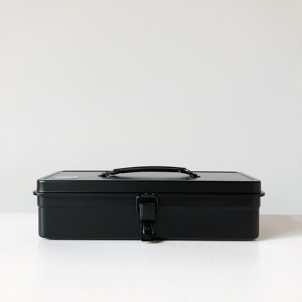 Simple pressed steel tool box with a flat top and rounded handle made in japan by Toyo Steel