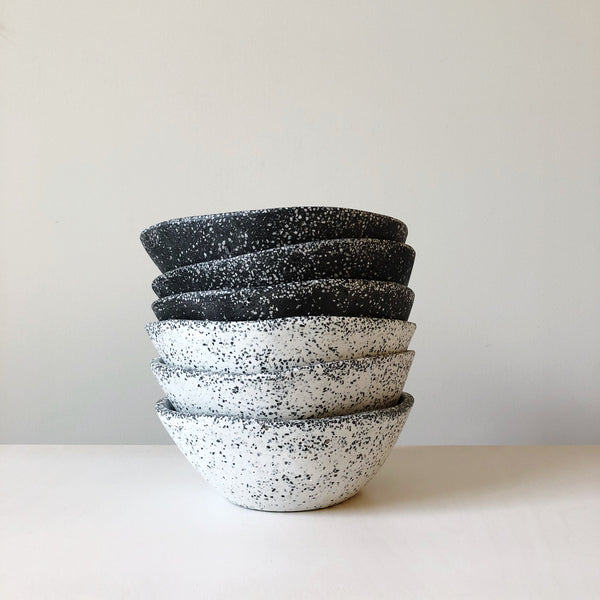 Modern organic form bowl made of resin and marble chips designed, hand made and detailed in Mexico at Port of Raleigh
