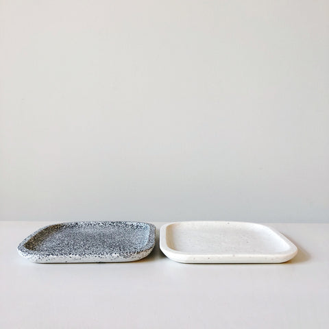 Modern organic form tableware made of resin and marble chips designed, hand made and detailed in Mexico