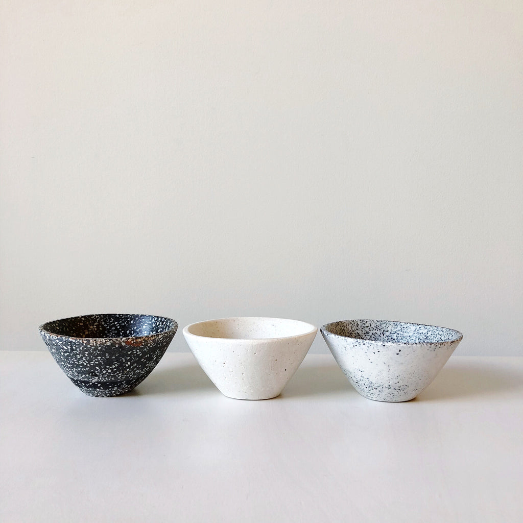 Modern organic form tableware made of resin and marble chips designed, hand made and detailed in Mexico at Port of Raleigh