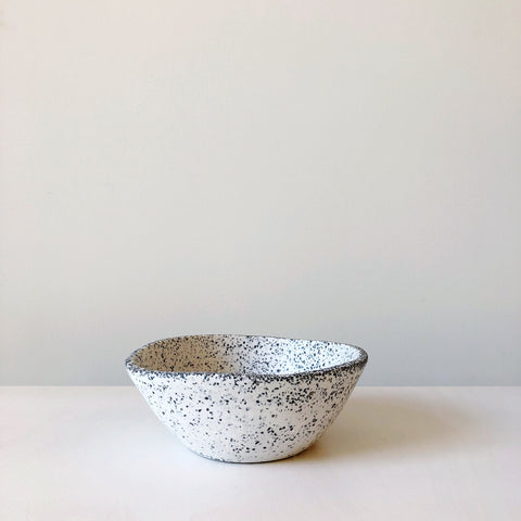 Modern organic form bowl made of resin and marble chips designed, hand made and detailed in Mexico