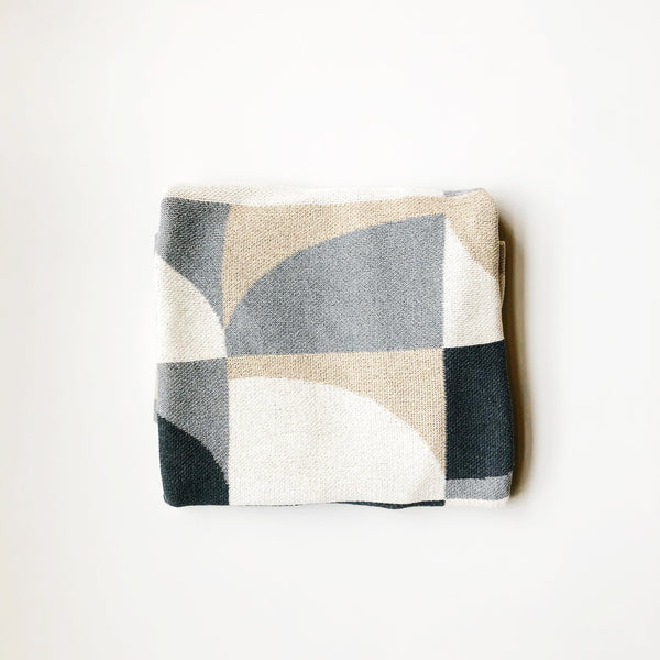 Modern pattern cotton throw blanket made in USA by Happy Habitat. Made using recycled cotton, machine washable, thick and cozy knit.