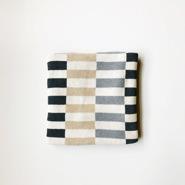 Modern pattern cotton throw blanket made in USA by Happy Habitat. Made using recycled cotton, machine washable, thick and cozy knit. at Port of Raleigh