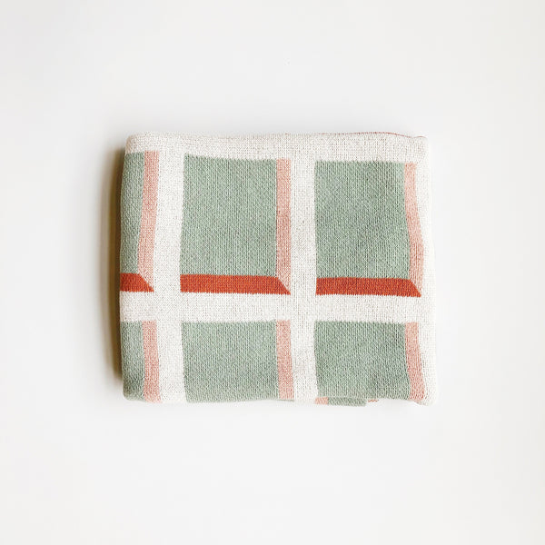 A modern and minimal blanket made with happy colors and simples shapes. Made with recycled cotton and acrylic. A super soft and happy accent for the home. Made in the USA by Happy Habitat.