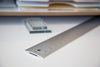 A large aluminum ruler that uses visual hierarchies of color and shape to articulate the process of measurement by Areaware