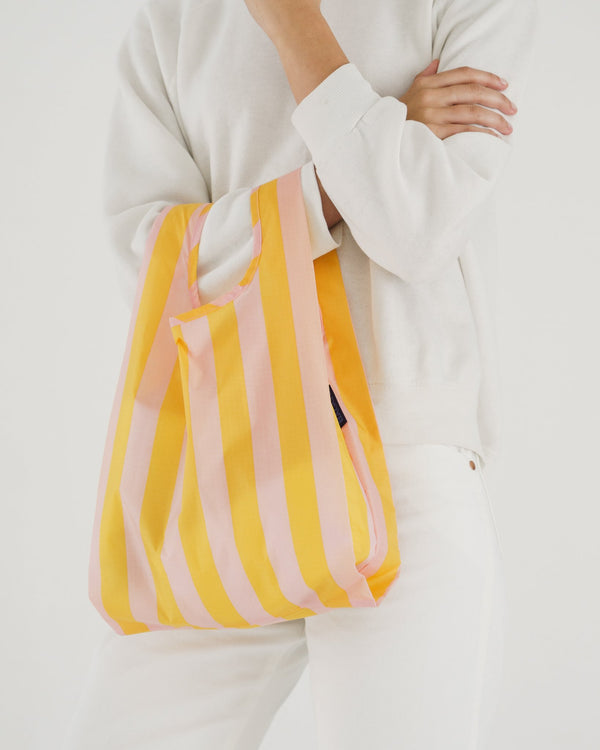 Baby Baggu resuable rip stop nylon shopping bag in marigold stripes for everyday use