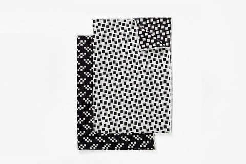 Bitmap Textile tea towels. This line of fine textiles celebrates the parallels between weaving and pixels; both rely on the idea of a grid spread across the surface of a medium by Areaware