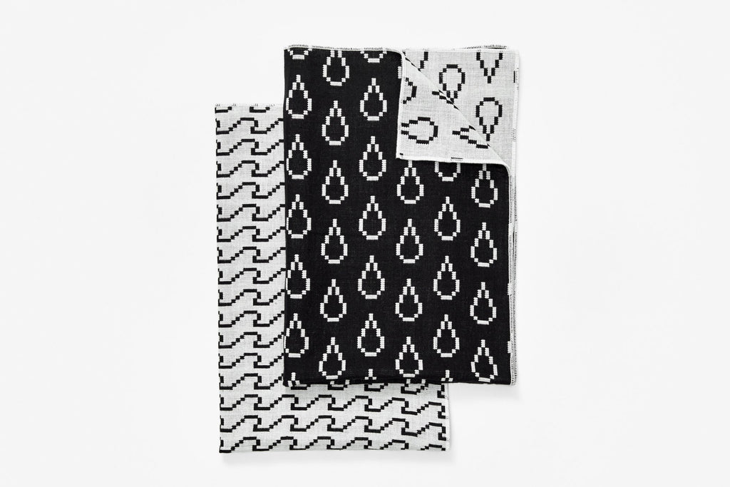 Bitmap Textiles tea towels set of 2. This line of fine textiles celebrates the parallels between weaving and pixels; both rely on the idea of a grid spread across the surface of a medium.   at Port of Raleigh