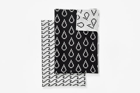 Bitmap Textiles tea towels set of 2. This line of fine textiles celebrates the parallels between weaving and pixels; both rely on the idea of a grid spread across the surface of a medium.