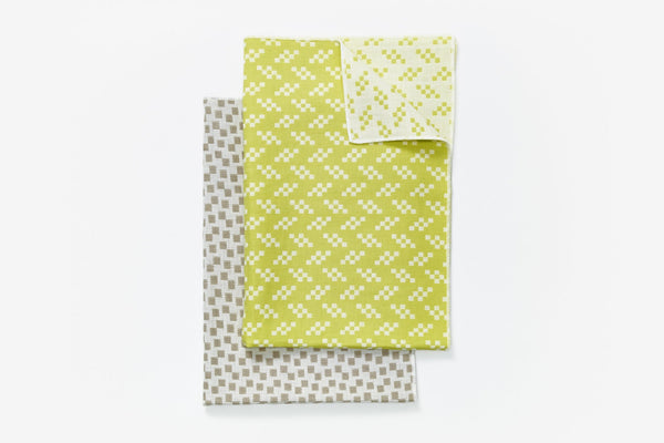 Bitmap Textile tea towels. This line of fine textiles celebrates the parallels between weaving and pixels; both rely on the idea of a grid spread across the surface of a medium by Areaware at Port of Raleigh