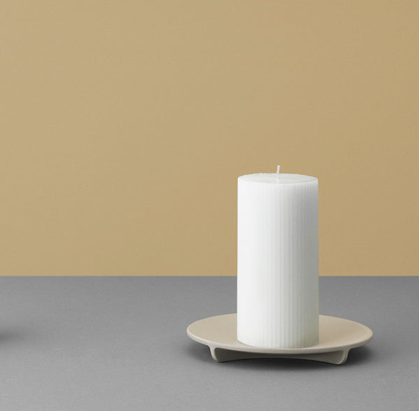 Simple structural column candle holder base made of cast iron by Normann Copenhagen. Modern home decor