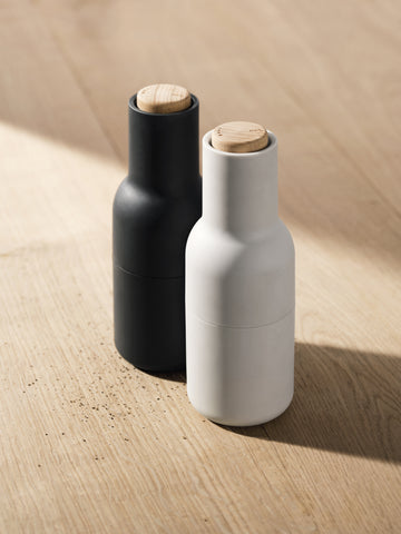 Modern pepper grinders with ceramic grinders and sleek silicone outer layer. Danish design by Norm Architects for Menu