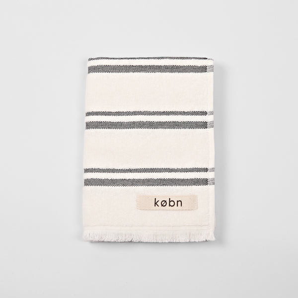 Modern striped hand towel with soft terry fabric on face and plain weave reverse framed by raw fringe detail on each end. Australian design by KOBN towels, inspire by Copenhagen, made in turkey