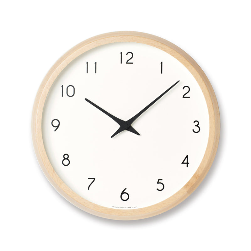 Modern wall clock with minimalist styling made in Japan by Lemnos of natural beech wood and glass at Port of Raleigh