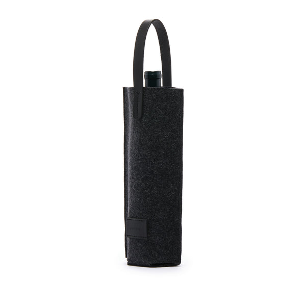 Single wine carrier made of Merino Wool keeps your beverage cold as needed and always protected while in transit. Made in Los Angeles by Graf Lantz at Port of Raleigh
