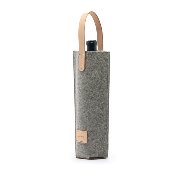 Single wine carrier made of Merino Wool keeps your beverage cold as needed and always protected while in transit. Made in Los Angeles by Graf Lantz
