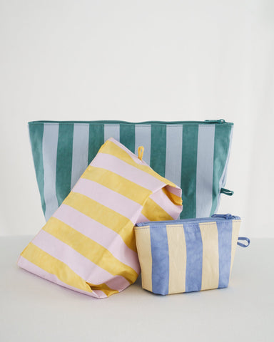 Go Pouch travel and organization zip pouches sold in a set of three with small, medium, large. Made of thick durable nylon by Baggu. Now with bright contrasting stripes.
