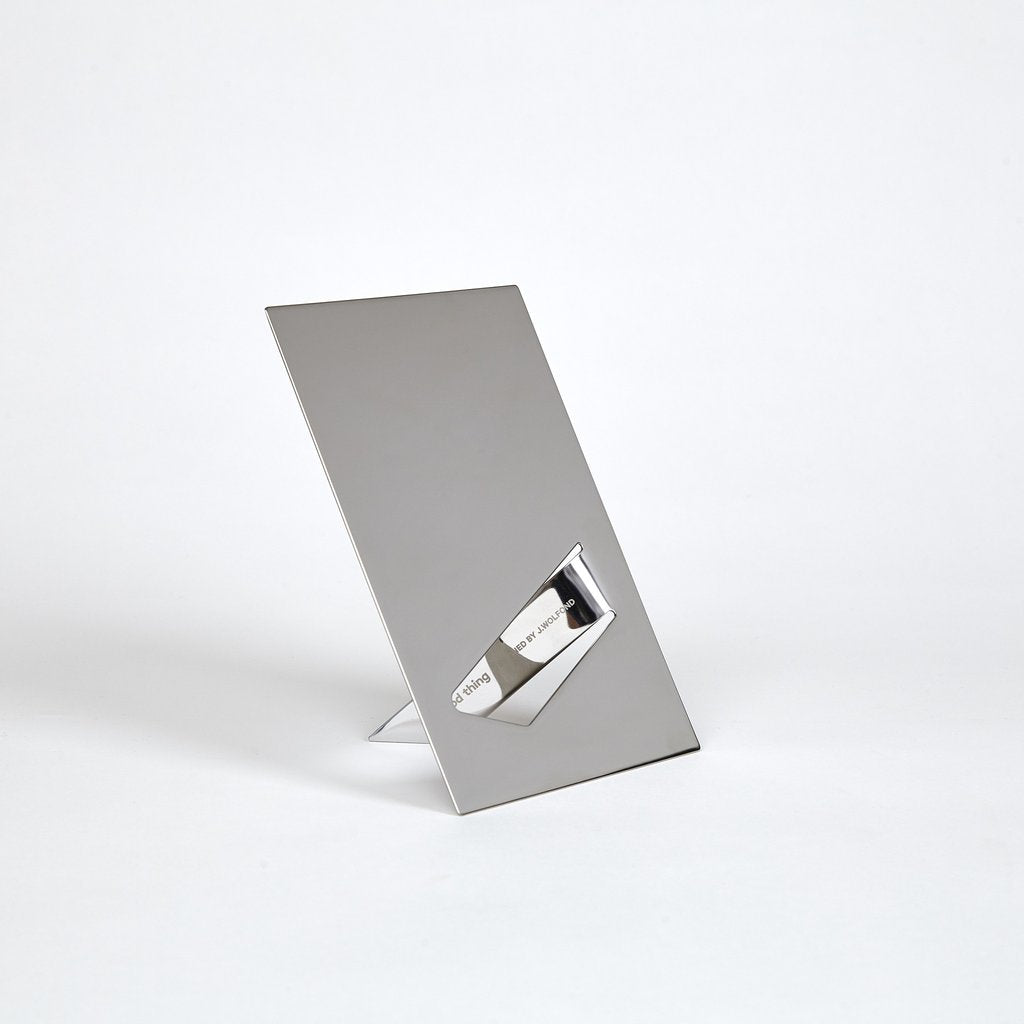 Minimalist surface mirror made of highly polished stainless steel by Good Thing at Port of Raleigh