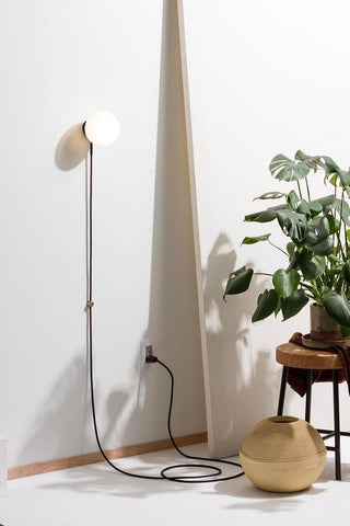 Modern and minimalist warm LED wall lamp that's architectural, seamless, space-saving, AND comes without the hassles of professional installation by Human Home