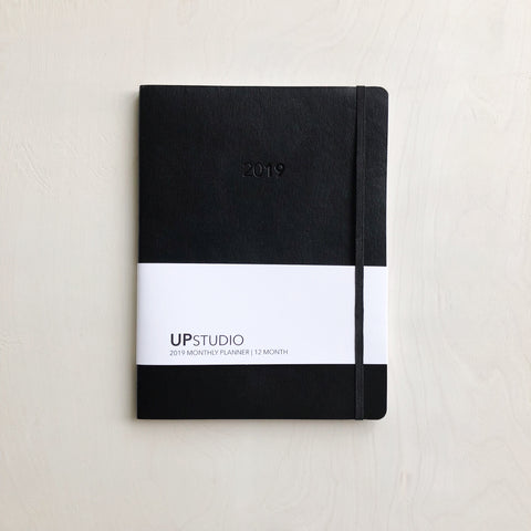 This simple, but detailed and thoughtfully-designed planner makes staying organized easier and sleek-looking. Created by UPStudio in Raleigh, NC, every page and every feature was carefully considered. Is has a black leather cover, elastic closure, and lots of graph paper in the back for notes overtime. This 12 month planner gives each user the ability to both plan well and stay flexible.