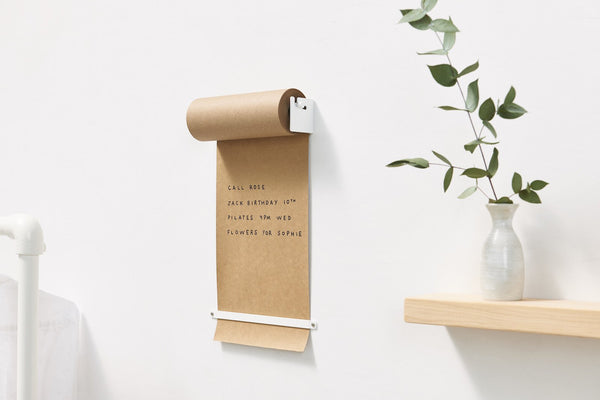 Modern kraft paper roller display and holder for personal, office, studio, and home use designed by George & Willy  at Port of Raleigh
