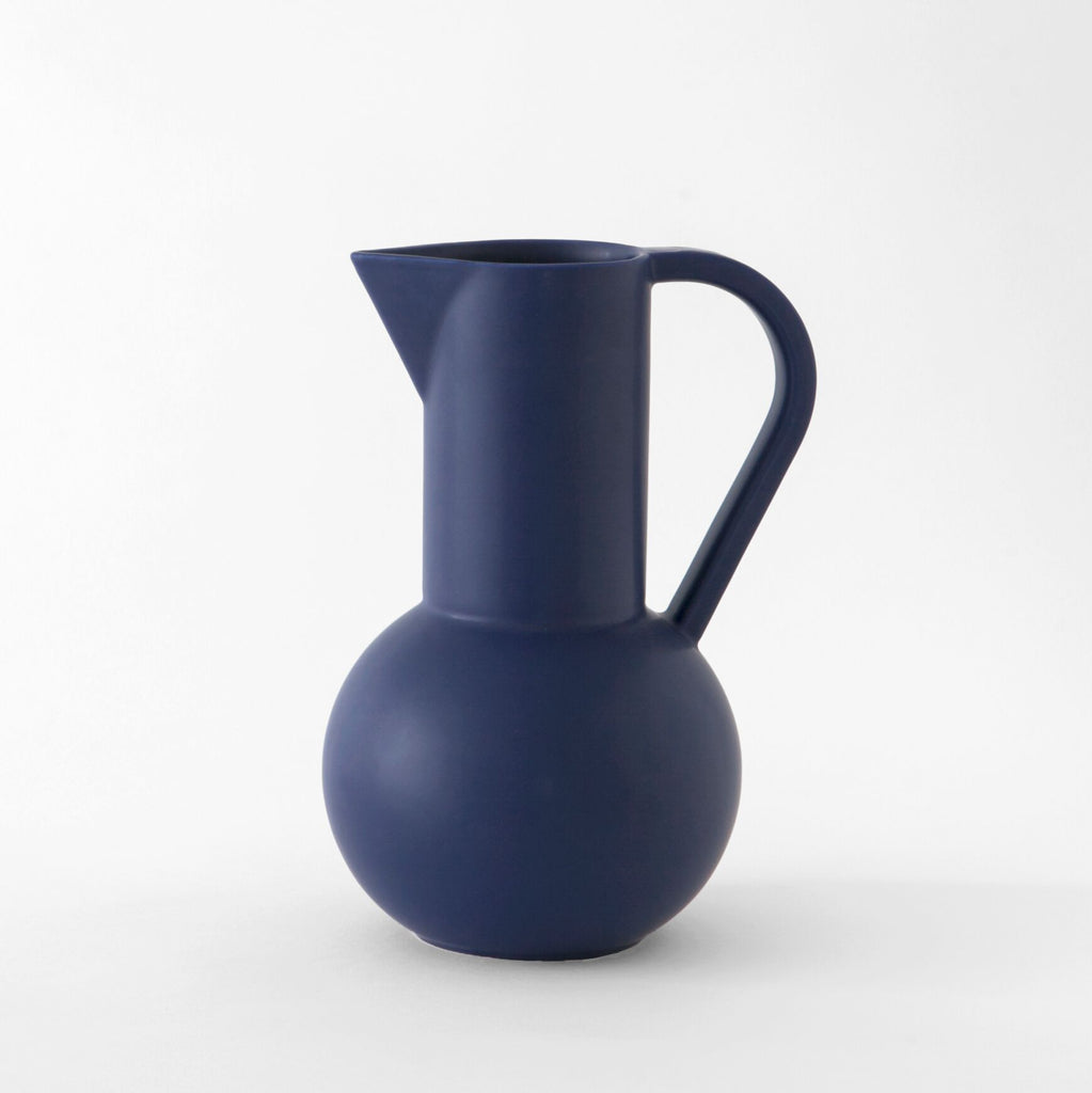 Inspired by still life paintings, the Strøm Collection Jugs from Raawii are a balance between function and form, exuding simplicity with a vivid flair. Handmade in Portugal by slip-cast technique, these striking ceramic pitchers are designed with purpose. at Port of Raleigh