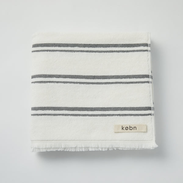 Modern beach / pool towel in Turkish towel plain weave with terry loops on the reverse side. Designed in Australia and made in Turkey, features stripes and fresh modern colors.