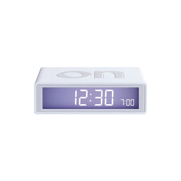 Modern, minimal, and simple, award-winning alarm clock that turns on and off with just a flip. Lightweight and wrapped in silicone, it is perfectly compact to dress your nightstand or pack away for travel. Has a touch sensor snooze and light activation, made by Lexon. at Port of Raleigh