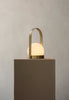 Modern and minimalist Portable and Chargeable Carrie LED Lamp by Danish design studio Menu. Now in a Brushed Brass finish.