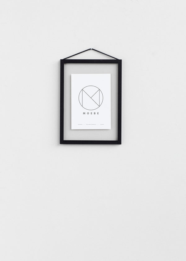 Making the everyday frame even more functional, Moebe designed the open back frame to allow for featuring smaller prints and objects. Using a simple rubber band, the frame Is both held together and easily hung on the wall. Frames are shaped to correspond with paper size A5 and come in natural oak, or black or white powder coated aluminum.