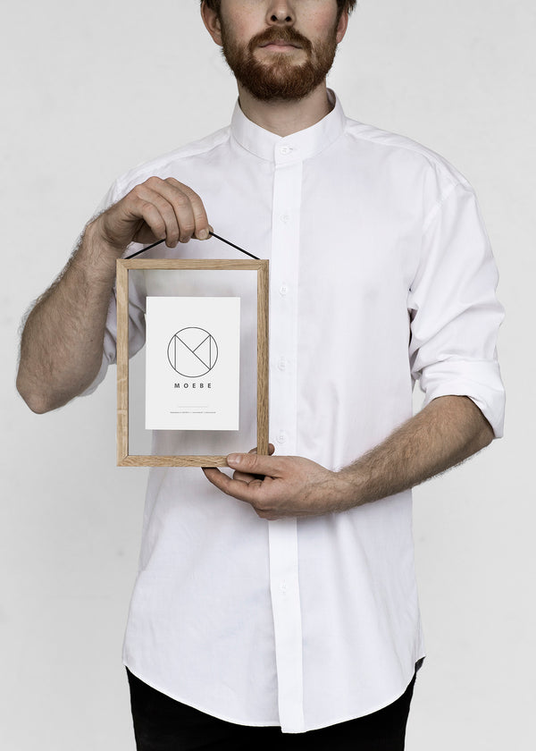 Making the everyday frame even more functional, Moebe designed the open back frame to allow for featuring smaller prints and objects. Using a simple rubber band, the frame Is both held together and easily hung on the wall. Frames are shaped to correspond with paper size A3 and come in natural oak, or black or white powder coated aluminum.