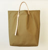 Light weight minimalist Ripstop Nylon tote bag with vegetable tanned leather adjustable straps made in USA in NYC by 864 Design at Port of Raleigh
