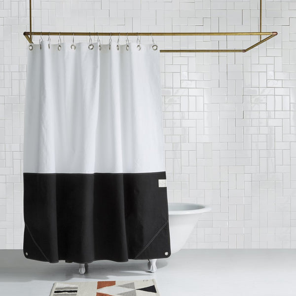Bringing the air and look of the beach to your bathroom, the new Beach House Orient shower curtain is made to take your self care to the next level. Inspired by the rich colors and textures from the beach, these color blocked curtains are made with 100% cotton canvas in Brooklyn, NY by Quiet Town.