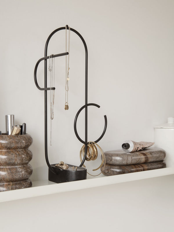 Keep your jewelry and accessories tidy with this minimal, sculptural jewelry stand. Made with a solid black marble base and curved wire arms for hanging your chains. Danish design by Ferm Living.