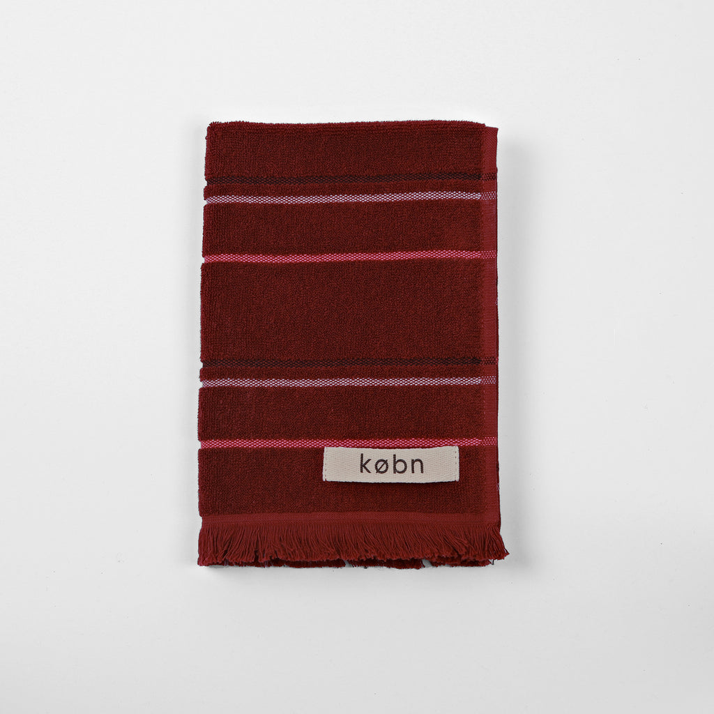 Modern striped hand towel with soft terry fabric on face and plain weave reverse framed by raw fringe detail on each end. Australian design by KOBN towels, inspire by Copenhagen, made in turkey at Port of Raleigh