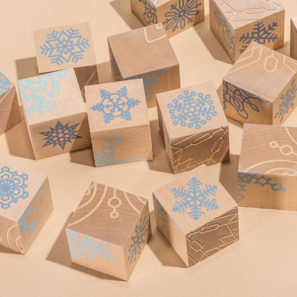 A classic style set of basswood blocks with snowflake designs for puzzle style matching or simple winter play. Comes in a set of 16, painted using non-toxic inks, made in USA by fruitsuper.